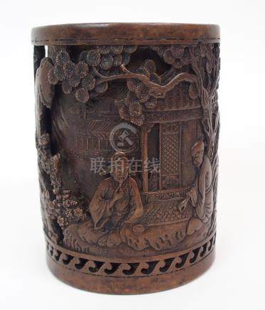 A CHINESE BRONZE BRUSH POT cast with figures playing a board game beneath pine and figures before