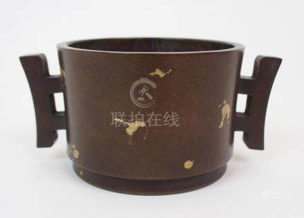 A CHINESE BRONZE GOLD SPLASH CENSER with pierced angular handles, Xuande mark, 20th Century, 12.