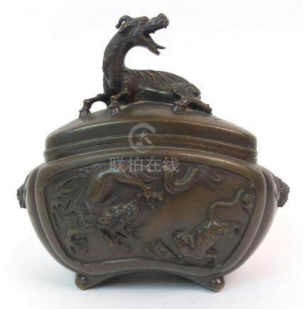 A CHINESE BRONZE INCENSE BURNER the cover cast with Kylin above panels of animals and mask