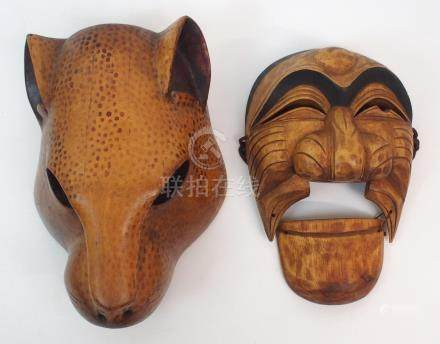 A JAPANESE CARVED WOOD LEOPARD MASK 26cm high and an articulated Noh theatre mask, 21cm high (2)