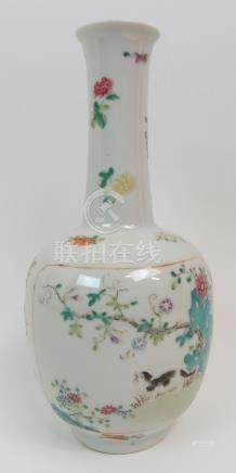 A CHINESE FAMILLE ROSE BALUSTER VASE painted with a panel of a cat beneath a flowering branch