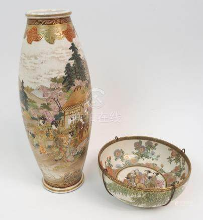 A SATSUMA OVIFORM VASE painted with families in gardens before houses and beneath a patterned
