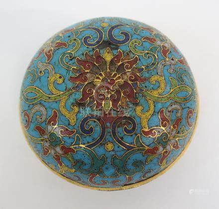 A CHINESE CLOISONNE AND GILT METAL CIRCULAR BOX AND COVER decorated with a central flowerhead with