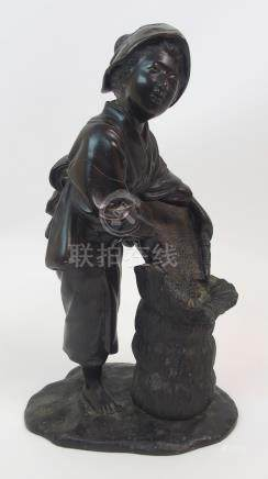A JAPANESE MEIJI BRONZE MODEL OF A WOMAN pouring grain into a sack on a shaped base, signed plaque