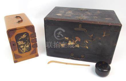 A JAPANESE MEIJI LACQUERED TEA CEREMONY BOX decorated with tea ware and foliage, signed above