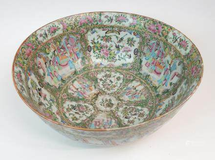 A CANTONESE FAMILLE ROSE PUNCH BOWL painted with panels of courtiers, birds, insects, flowers and