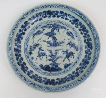 A CHINESE BLUE AND WHITE TWO DEER DESIGN DISH painted with a central panel with two deer beneath a