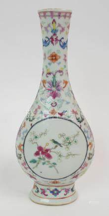 A CHINESE BOTTLE SHAPED VASE painted with two circular medallions with birds in flowering branches