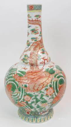 A CHINESE FAMILLE ROSE/VERTE BALUSTER VASE painted with fish and a scrolling dragon amongst swirling