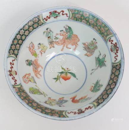 A CHINESE FAMILLE VERTE BOWL the interior with immortal figures surrounding a peach and beneath a