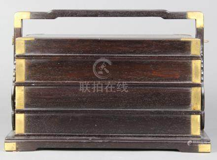 Chinese three-tiered zitan seal box, with rectangular cases set on a base with a bracket handle