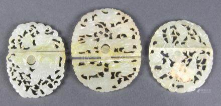 (lot of 3) Pairs of Chinese jade belt plaques: one with a child mounted on qilin; one with