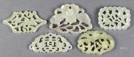 (lot of 5) Chinese jade/hardstone plaques: three of floral motifs; and two featuring dragons,