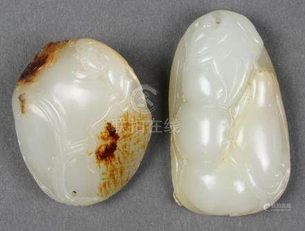 (lot of 2) Chinese jade toggles, consisting of a pebble accented by a lotus, crab and squirrel;
