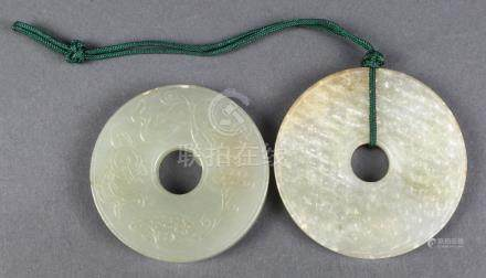 (lot of 2) Chinese jade bi-disc, one carved with treasures in low relief including double gourd,