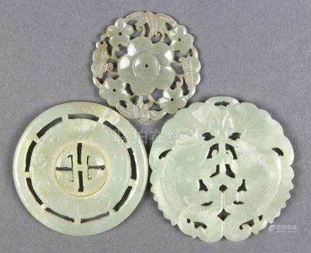 (lot of 3) Chinese jade plaques: one pierced with prunus; one with a movable disc to the center; the