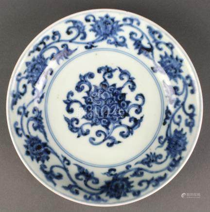 Chinese underglaze blue porcelain plate, the interior and exterior with stylized lotus scrolls, base