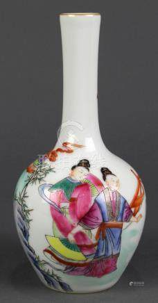 Chinese famille rose small porcelain vase, with a stickneck and globular body featuring a monk and