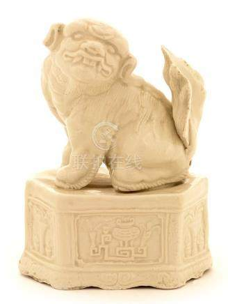 A Chinese blanc de chine porcelain figure of a Buddhist lion of fu dog.