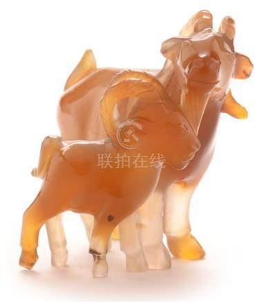 An early 20th Century Chinese carved agate group of a goat and kid.