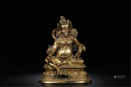 TIBETAN GILT BRONZE SEATED YELLOW JAMBHALA