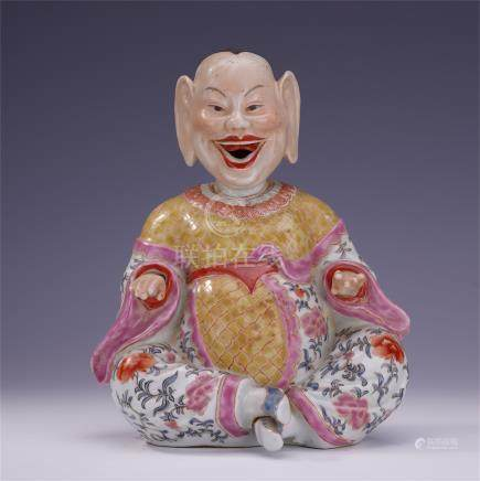 CHINESE PORCELAIN FAMILLE ROSE SEATED FIGURE
