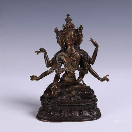CHINESE BRONZE SEATED SIX ARM GUANYIN
