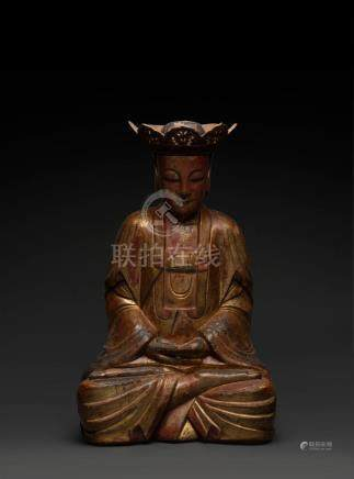 A Chinese lacquered wooden figure of Buddha seated in dhyana