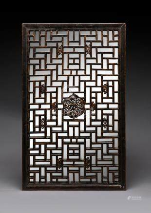 A Chinese window screen with later mirror backing, 19th/20th