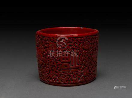 A Chinese cinnabar lacquer bracelet, 19th century, 6cm wide