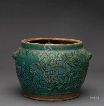 A Chinese earthenware pot with jade green glazed dragon moti