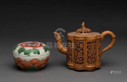 A Chinese reticulated pottery teapot together with a famille