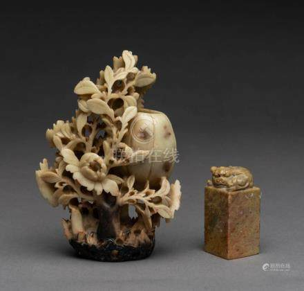 A Chinese carved soap stone figure and seal, 20th century, 1