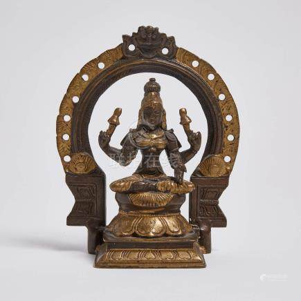 南印度 鎏金銅女神坐像 A Parcel-Gilt Bronze Seated Figure of a Female Deity, South India