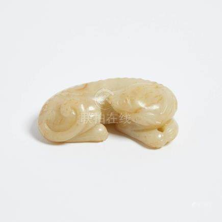 青白玉沁色臥瑞獸 A Pale Celadon Jade Carving of a Recumbent Feline