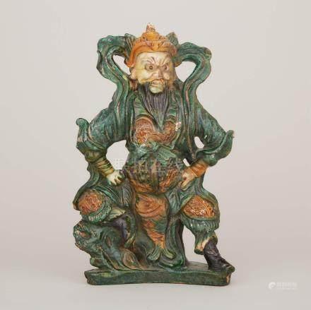 明 泰然自若三彩關羽坐像 A Green and Ochre-Glazed Pottery Tile Maker's Figure of Guandi, Ming Dynasty
