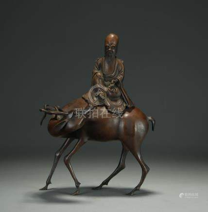 An antique bronze censer; man riding deer