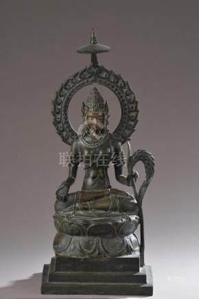 CHINE - XIXe ou XXe siècle.- Brûle-parfum à anse en bronze patiné ciselé de gru