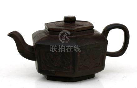 A Chinese Yixing pottery tea pot of hexagonal form