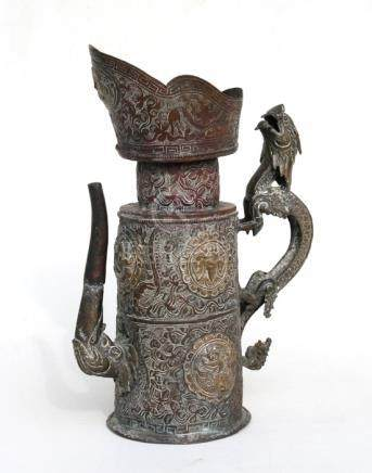 A Mongolian copper & brass butter tea jug with applied roundels decorated with mythical beasts and
