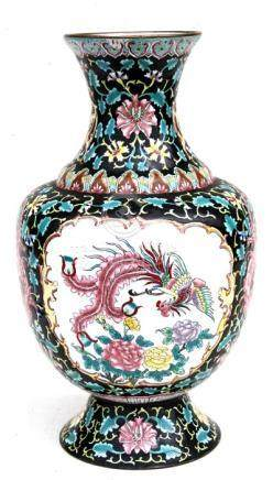 A Chinese Canton enamel vase decorated flowers and birds on a black ground. 37cm (14.5 ins) high