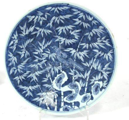 A blue & white charger decorated with a bird amongst bamboo, 33cms (13ins) diameter.Condition Report