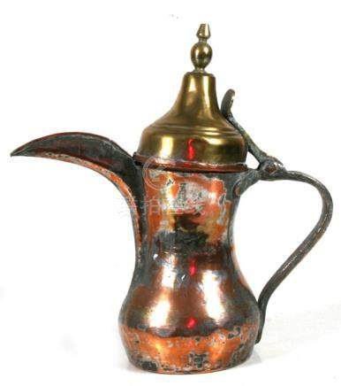 A tinned copper & brass Turkish / Islamic dallah coffee pot, 29cms (11.5ins) high.