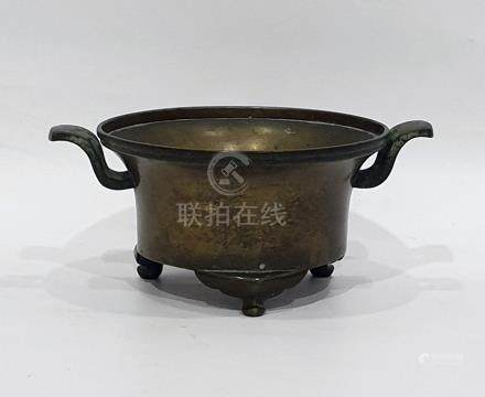 Chinese bronze censer,with everted rim and pair tab handles, on 3 scroll feet, bears Hsuan Te 6-