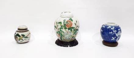 Chinese porcelain ginger jar and cover, ovoid and painted with peonies, foliage and rockwork, 19cm