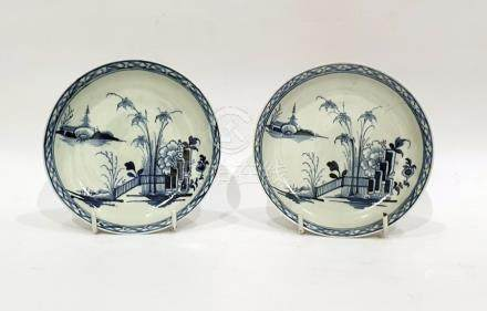Pair Chinese porcelain saucers decorated in underglaze blue with fence and plants, brocade border,