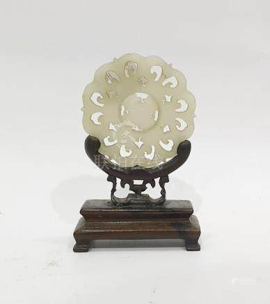 Chinese carved mutton fat jade medallion, stylised flowerhead pattern with revolving circular