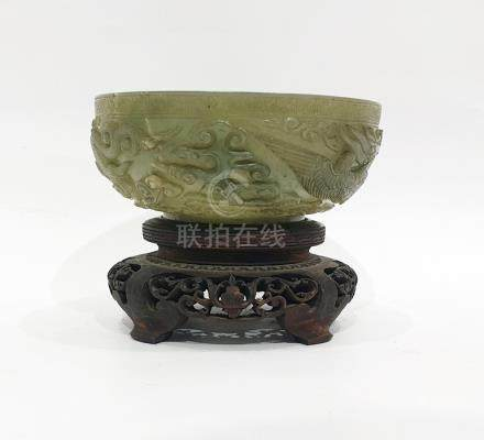 Chinese carved green jade bowl, carved autour in relief with dragon, ho-ho bird and scrolling