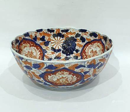 Japanese Imari porcelain punchbowl painted in typical colours, with floral medallions, on a