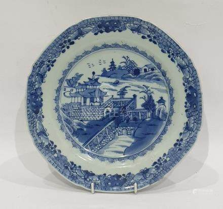 18th century Chinese porcelain plate painted in underglaze blue with lakeside pagoda and gardens,